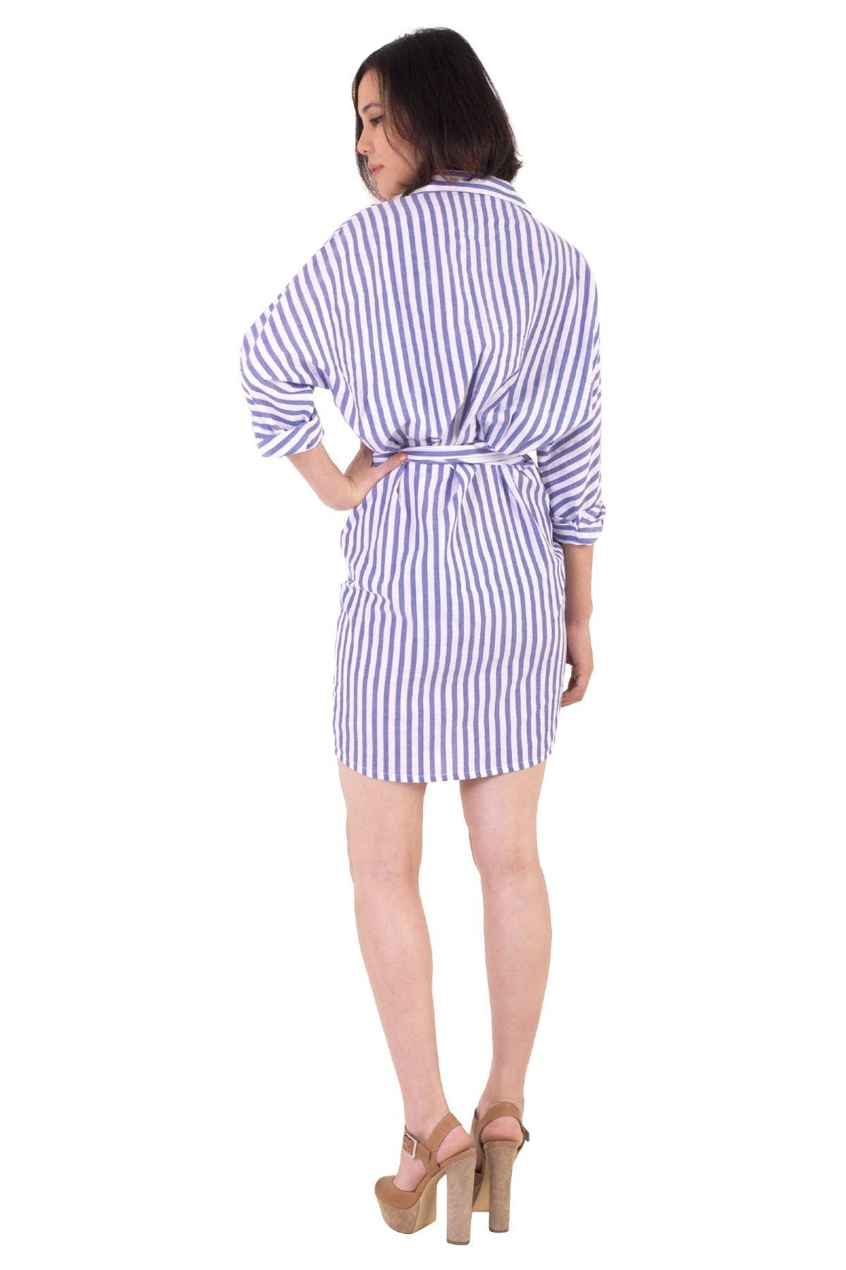 Designer Diane Von Furstenberg poses wearing one of her signature wrap dresses