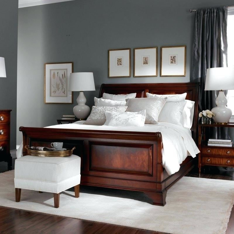 Blue bedroom with wainscoting! Dark brown furniture